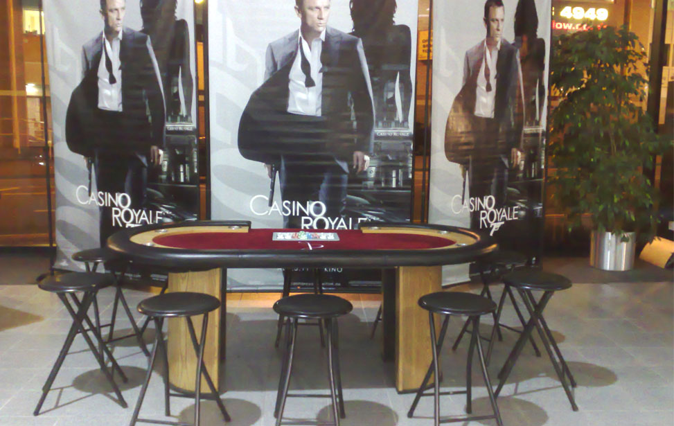 Sytner Cardiff M1 Coupe Launch - Texas Hold'Em Table and metal stools along with 3 X'Casino Royale' backdrops